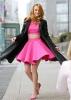Рыжая девушка в розовом платье
